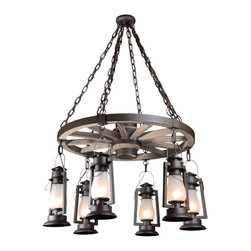 """Pioneer Series - A perfect way to light the great room of your home is with this magnificent """"American Made"""" Pioneer wagon wheel chandelier. We hand build the heavy duty wagon wheel and metal hardware and then suspend the very accurate """"cold blast"""" lanterns from below the wheel. The finish on the heavy gauge chain and wheel hardware will perfectly match the selected finish on the lanterns. Available with 4, 6 or 8 lanterns, our authentic wagon wheel chandeliers are a perfect finishing touch the your rustic great room setting."""