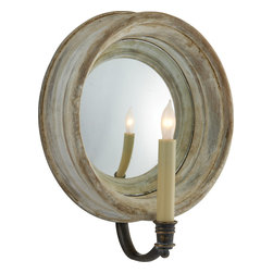 Chelsea Medium Reflection Sconce - Why not choose lighting that reflects your good taste? With a charming, candle-inspired bulb beaming in a lovely round mirror, this sophisticated sconce makes any wall a little warmer.