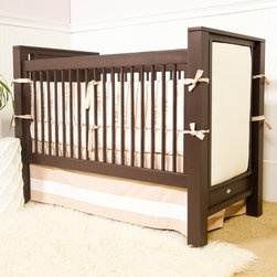 "Newport Cottages - Newport Cottages Ricki Upholstered Crib - Newport Cottages creates relaxing and happy nurseries and bedrooms with traditional, bench made furniture. Time-honored craftsmanship gets a modern twist with the clean lines and simple style of the Ricki crib. This versatile baby bed features upholstered panels for a one-of-a-kind design, dual level fixed gates and an optional under-crib storage drawer. The furnishing is available in several finishes and accent colors with an optional toddler guardrail kit. Available with a choice of fabric. Made in the USA and completed with non-toxic, low VOC finishes. Available with a standard or distressed finish. Distressing on stained finishes not recommended. 32""W x 57""D x 54""H. Some assembly required. Mattress heights: 22"", 18"" and 14"". Crib mattress not included. COM fabric: 3 yards required*To further customize with additional finish and hardware options, please email shop@laylagrayce.com or call (877) 907-1322 for further details."