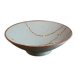 None - Spring Blossom Serving Bowl - This Earthenware serving bowl artistically captures the beauty of spring with images of the Japanese cherry blossom on a sky-blue background. Constructed with the finest clays and dyes,it is completely nontoxic for contamination-free entertaining.