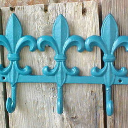 Beach Chic Intense Turquoise Fleur de Lis Cast Iron Wall Rack by Ruby's Girl - Vintage cast iron hooks are a great way to add wall storage and a charming wall feature at the same time.