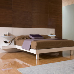 """Hokku Designs - Chico Platform Bed - Features: -Lighted glass shelves that turn on and off at the touch of button.-European slat system.-Includes two integrated nightstands.-Wood construction.-White lacquer finish.-Chico collection.-Powder Coated Finish: No.-Gloss Finish: No.-Finish: White.-Frame Material: Wood.-Solid Wood Construction: Yes.-Upholstered: No.-Non Toxic: Yes.-Scratch Resistant: No.-Joinery Type: Camlock.-Mattress Included: No.-Box Spring Required: No.-Headboard Storage: Yes -Number of Headboard Drawers: 2..-Slats Required: Yes -Slats Included: Yes..-Center Support Legs: Yes.-Adjustable Headboard Height: No.-Adjustable Footboard Height: No.-Wingback: No.-Trundle Bed Included: No.-Attached Nightstand: Yes.-Cable Management: Yes.-Built in Outlets: No.-Lighted Headboard: Yes -Light Type: LED lighting on the nightstand.-Bulb Type: LED..-Finished Back: Yes.-Reclaimed Wood: No.-Distressed: No.-Collection: Chico.-Eco-Friendly: Yes.-Recycled Content: No.-Wood Moldings: No.-Canopy Frame: No.-Hidden Storage: No.-Jewelry Compartment: Yes.-Swatch Available: No.-Commercial Use: Yes.Specifications: -CARB Compliant: Yes.Dimensions: -Overall Height - Top to Bottom (Size: California King): 40.2"""".-Overall Height - Top to Bottom (Size: King): 40.2"""".-Overall Height - Top to Bottom (Size: Queen): 40.2"""".-Overall Width - Side to Side (Size: California King): 116"""".-Overall Width - Side to Side (Size: King): 120"""".-Overall Width - Side to Side (Size: Queen): 104"""".-Overall Depth - Front to Back (Size: California King): 88.9"""".-Overall Depth - Front to Back (Size: King): 84.3"""".-Overall Depth - Front to Back (Size: Queen): 84.3"""".-Headboard Dimensions Height (Size: California King): 40.2"""".-Headboard Dimensions Height (Size: King): 40.2"""".-Headboard Dimensions Height (Size: Queen): 40.2"""".-Headboard Width Side to Side (Size: California King): 116"""".-Headboard Width Side to Side (Size: King): 120"""".-Headboard Width Side to Side (Size: Queen): 104"""".-Shelving: No.-Cabinet: No.-Trundle Bed: """