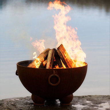 """Fire Pits - Great for Fall and Winter - You'll appreciate the contemporary design of the Nepal 36"""" Fire Pit, its artistry and physical composition unsurpassable by any fire pit on the market. Symbolic of ancient incense burners, the Nepal is shaped like a large caldron, its round basin host to brilliant yellow flames. Additionally, this wood burning fire pit is made from the heaviest gauge steel available, ensuring that you'll have this functional piece of fire pit art for many years in the future. Fire Pit Art The Nepal 36"""" Fire Pit is not just a practical fire pit; it is a piece of art in its own right. It has a standard iron oxide patina finish on the outside. The iron oxide patina will darken a little with time before becoming permanent. The inside is coated with a high temperature resistant paint and has a rain drain in the bottom. The standard triad base of the fire pit has an inside weld to give a smooth and clean look on the outside while maintaining the integrity of the piece."""