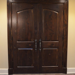 Liberty Door Series - This double door unit is the L-201A Common Arch Pair in Rustic Hickory. This door is framed with a custom Patriot Hardwood Moulding casing and hand finished to complete this beautiful look.