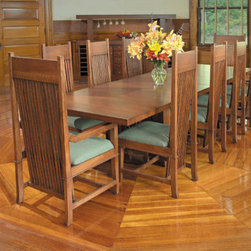 """Copeland Furniture - Frank Llloyd Wright Dana-Thomas 84 - 124"""" W x 42"""" D Grand Extension 11 Piece Din - The Dana-Thomas Dining Tables were re-issued in 2006 by Copeland Furniture . Each piece bears a unique serial number, its date of manufacture, and the signature. Features: -Set includes dining table, 8 side chairs and 2 arm chairs. -Dana-Thomas Dining Room collection. -Material: Solid hardwood. -Self-storing leaves generously accommodates twelve people. -Made in the USA."""