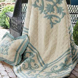 Bridgeton Quilt - Bridgeton borrows its design from the vining ironwork found on doors and window boxes all over the south of France. Centered with an intricate medallion and framed with a scrolling border treatment, outline embroidery creates the look of an appliquéd textile. Beautifully printed on soft, slubby cotton/linen blend, lattice quilt stitching adds another tactile dimension to this elegant piece.