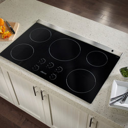 """Dacor Renaissance 36"""" Induction Cooktop - With today's modern kitchen consuming as much as 40% of all household energy, the earth-friendly Renaissance 36"""" and 30"""" Induction Cooktops by DACOR cook with over 90% energy efficiency, making induction the fastest and most energy efficient form of cooking on the planet today."""