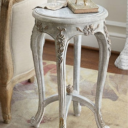 Chambourd Gueridon - Petite occasional tables called guéridons originated in 17th century France, where they took on many forms and served infinite uses. Ours, inspired by high Louis XIV style, is characterized by its curvaceous cabriole legs, arched stretchers and gilded hand-carved scrollwork. Finished with a chalky antique grey patina and topped with inset marble, we picture it showcasing flowers in an entry or supporting a table lamp beside a sofa or armchair.