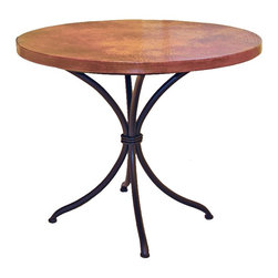 "Mathews & Company - Italia Bistro Table with 36"" Round Top - The classic design of this bistro table will take you to a simpler place, perhaps to that laid back country kitchen or a sidewalk cafe. Great in your kitchen, breakfast nook or patio, this table is the perfect place for a quiet cup of coffee alone or a simple meal with a friend. Enjoy the rustic look and feel of the fired copper table top, supported on the sleek, hand-wrought iron base. Choose the traditional black iron finish for a classic look, or make your own unique statement with a rust, aged pewter, or aged bronze finish. If you prefer to have your own table top built, or have an existing one to use - Choose ""No Top"" from the drop-down menu and order the iron base only. Pictured in Copper top and Black finish."