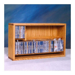 """Wood Shed - 200 Series 110 CD Multimedia Tabletop Storage Rack - Organize your office environment while enhancing the appearance wih this rack! Solid oak is used for its strength and durability. This product looks great as it is solid wood and does not have any screws. Features: -Holds 110 CD's.-Distressed: No.-Collection: 200 Series.-Country of Manufacture: United States.-Commercial Use: Yes.-Material: Solid oak.-Solid Wood Construction : Yes.-Number of Items Included: 2 items: 1 rack and 1 slider.-Scratch Resistant: Yes.-Heat Resistant: No.-Stain Resistant: Yes.-Drawers Included: No.-Exterior Shelves Included: Yes -Number of Exterior Shelves: 2.-Adjustable Exterior Shelves: No..-Cabinets Included: No.-Recycled Content: No.-Eco-Friendly: No.-Storage Capacity: 110 CD's.-Wall Mountable: Yes.Specifications: -ISTA 3A Certified: No.Dimensions: -Overall Height - Top to Bottom: 14.5"""".-Overall Width - Side to Side: 24.25"""".-Overall Depth - Front to Back: 6.5"""".-Drawer: No.-Shelving: -Shelf Height - Top to Bottom: 5.5"""".-Shelf Width - Side to Side: 22.75"""".-Shelf Depth - Front to Back: 6""""..-Overall Product Weight: 18 lbs.Assembly: -Assembly Required: No.Warranty: -Product Warranty: 6 months."""