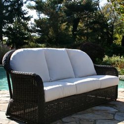 Anacara Mariner All-Weather Wicker Sofa - Additional features: Designed for outdoor use - can be used indoors too! Generously proportioned, oversized design for maximum comfort Comfortably seats 2-3 people Comes fully assembled Available online exclusively on PFUSA.com A blend of elegance, style, and contemporary appeal, the Anacara Mariner All-Weather Wicker Sofa is just what you need to catch up with friends in style. The oversized design will seat you and up to two friends in such comfort that you might end up chatting way longer than you had planned! Boasting a large braided weave, which is beautifully turned to make a very comfortable sloping arm, and a traditional weave pattern reminiscent of the South Pacific, this sofa will retain its handsome appearance even after years of use. Woven over a durable, welded aluminum frame, the all-weather resin wicker mimics the look of natural willow, while subtle variations in color brought about by interweaving varying shades, help highlight its natural willow look. And the best part is that you can leave this sofa outdoors all year long and all you'd need to do by way of maintenance is just hose it off to clean! The deep, plush seat and back cushions are available in your choice of a variety of different designer options, from muted solids to brightly patterned prints. Fabric Options:Choose from to grades of fabric. Grade A is an outdoor fabric with a printed color or pattern. Grades B is a solution-dyed fabric. Both are designed for outdoor use, however Grade B fabrics, that differ only slightly in their manufacturing process, are more fade resistant. Solution dying refers to the color being soaked into each thread. Printed fabrics have the color on the top side of the fabric only. We recommend Grade B fabrics for extremely sunny regions or patios that are in direct sunlight. Grade A fabrics are amazing quality fabrics, but will fade quicker than Grade B when used in direct sunlight. Grade A fabrics have a 1-year fade warranty and Grade B fabrics have a 2-year fade warranty. Important NoticeThis item is custom-made to order, which means production begins immediately upon receipt of each order. Because of this, cancellations must be made via telephone to 1-800-351-5699 within 24 hours of order placement. Emails are not currently acceptable forms of cancellation. Thank you for your consideration in this matter.