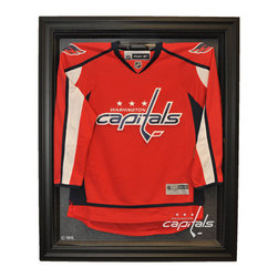 Caseworks - Washington Capitals NHL Cabinet Style Jersey Display Case in Black - Wow your friends with the #1 selling hockey jersey case in the world. The easy, open-and-close, cabinet style, Genuine Black Wood framed case enhances the presentation of your collectible jersey. Without a doubt, the finest display case in sports. Includes your favorite NHL team logo. Measures 42-inch High x 34 1/4-inch Wide x 3-inch Deep. Jersey not included. Made in USA. This item is perfect for your Man Cave, Game Room, Office or anywhere you want to show love for your favorite team. The item shown inside the display case is for illustration purposes only and is not included with your display case purchase.
