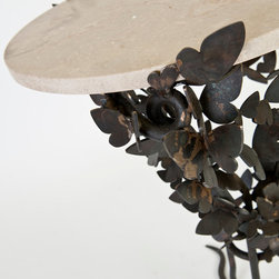 Butterflies - Our butterfly table is available in a variety of finishes and stone top options, including thick geode tops.