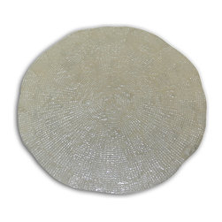 Sided Ivory Ebb Tide Capiz Placemat - Set of 4 - A slightly uneven edge gives an organic air to the Single Sided Ivory Ebb Tide Capiz Placemat which enhances its opulent wonder. Made from tiny, expertly-fitted reclaimed tiles of this delicate, nearly transparent shell, the placemat is radiant and dazzling enough that guests will want to peek under their plates to see more of the sparkle! This gorgeous shell mat is also excellent for defining the area of a centerpiece arrangement.
