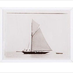 """Framed Vintage Boat Print - Reproduced from an original photograph from France found by our prop stylist, our Boat Wall art is printed on matte photo paper in rich sepia tones. Overall: 42"""" wide x 32"""" high Printed on matte photo paper in sepia tones. Framed in a white wood gallery frame with a Plexiglas front cover. Mounting hardware not included."""