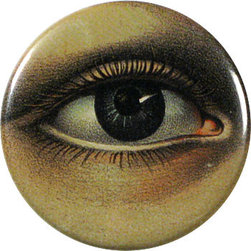 Mirror button - This decoupaged pocket mirror by John Derian plays on a few optical illusions. The realistic eye and circular shape of the mirror make it appear like the eye is peering through a porthole. And the design is on the back of a mirror, which plays on the concept of looking at oneself in the mirror.