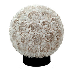Floral Clamrose Shell Sphere Table Lamp - Every single clamrose seashell is hand set onto an acrylic sphere creating a pattern that resembles a flower petal. Lit or unlit this table lamp is ornate and fits a wide range of home styles despite its tropical, coastal influence.