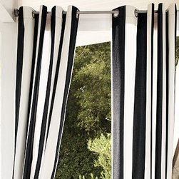 """Sunbrella(R) Awning Stripe Outdoor Grommet Drape, 50 x 96"""", Black - Frame your outdoor space with our stylish, easy-to-hang drape. Woven of stain-resistant polyester. Finished with weather-resistant nickel grommets. Can also be used indoors for extra light filtration. Black and White Stripe. Machine wash. Watch a video on {{link path='/stylehouse/videos/videos/h2_v1_rel.html?cm_sp=Video_PIP-_-PBQUALITY-_-HANG_DRAPE' class='popup' width='420' height='300'}}how to hang a drape{{/link}}. Catalog / Internet only. Imported."""