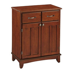 HomeStyles - Buffet in Cherry Finish - For entertaining or simple family gatherings, this buffet will be a handy storage unit that provides a traditional influence. Cherry finish adds depth to the paneled doors and raised drawer fronts. Brushed steel handles, knobs and hinges provide an updated accent. * Two utility drawer suspended on metal drawer slides. Adjustable shelf for plenty of inside storage. Brushed steel hardware. Clear coat finish to help protect against wear and tear from normal use. Equipped with adjustable floor levelers. Made from Asian hardwood and wood products. Made in Thailand. Assembly required. 29.25 in. W x 15.87 in. D x 36 in. HThis buffet is designed to provide added storage and workspace for the kitchen and dining areas of the home.