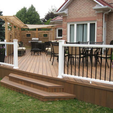 Traditional Deck by Forest Fence & Deck Co Ltd.