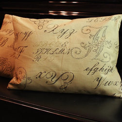 Brown Alphabet Calligraphy Script Pillow Cover by Shaddock Designs - These traditional pillows are printed with fanciful calligraphy letters. I love how swirly and extravagant calligraphy can look.