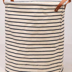 Cotton and Linen Drawstring Laundry Bin by Lost Pigeon - French sailor stripes will forever be a seaside mainstay. This storage bin, made from linen with a waterproof lining, is perfect for seaside laundry.