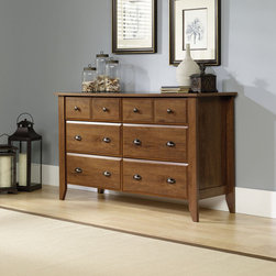 """Sauder - Shoal Creek 6 Drawer Dresser - With country roots and contemporary soul, this inviting, casual appearance offers a stylish alternative to the traditional home office. Tapered legs and sculpted drawer and door edges confirm this design's country origin. Features: -Six drawers for storage.-Bottom four drawers extra deep for added storage.-Made in USA.-Solid Wood Construction: No.-Powder Coated Finish: No.-Gloss Finish: No.-Non Toxic: Yes.-Scratch Resistant: No.-Storage Function: Clothing.-Drawers Included: Yes -Number of Drawers: 6.-Drawer Interior Finish: Wood.-Drawer Glide Material: Metal.-Soft Close or Self Close Drawer Glides: Yes.-Safety Stop: Yes.-Ball Bearing Glides: Yes.-Joinery Type: Cam Screw.-Drawer Dividers: No.-Felt Lined Drawers: No.-Drawer Handle Design: Knobs and pulls..-Clothing Hooks Included: No.-Clothing Rod Included: No.-Foot Design: Tappered.-Cabinets Included: No.-Hardware Finish (Finish: Jamocha Wood): Pewter.-Hardware Finish (Finish: Oiled Oak): Antique Bronze.-Hardware Finish (Finish: White): Antique Nickel.-Hidden Storage: No.-Interchangeable Panels: No.-Mirror Included: No.-Hutch Included: No.-Finished Back: No.-Distressed: No.-Collection: Shoal Creek.-Swatch Available: Yes.-Commercial Use: No.-Country of Manufacture: United States.-Eco-Friendly: Yes.-Product Care: Damp Cloth.Specifications: -FSC Certified: Yes.-EPP Compliant: Yes.-CPSIA or CPSC Compliant: Yes.-CARB Compliant: Yes.-JPMA Certified: No.-ASTM Certified: Yes.-ISTA 3A Certified: Yes.-PEFC Certified: Yes.-General Conformity Certificate: Yes.-Green Guard Certified: No.Dimensions: -Overall Height - Top to Bottom: 33.031"""".-Overall Width - Side to Side: 54.646"""".-Overall Depth - Front to Back: 18.425"""".-Overall Product Weight: 142 lbs.Assembly: -Assembly Required: Yes.-Tools Needed: Hammer and phillip's screwdriver.-Additional Parts Required: No.Warranty: -Product Warranty: 5 years."""