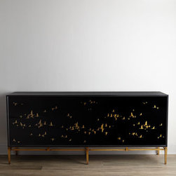 "John-Richard Collection - John-Richard Collection ""Marla"" Console - This remarkable console showcases migrating birds that are reverse painted on black glass. Black glass on the top and sides and golden legs complete the look. From the John-Richard Collection. Handcrafted of acacia wood, wood composite, iron, and reve..."