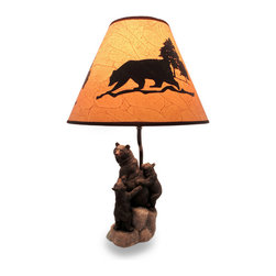 Zeckos - Sculptural Black Bear Family Desk Lamp with Leather Look Shade - This beautifully sculpted cast resin lamp will add a rustic accent to your home or office. Featuring a mother black bear with her two precocious cubs resting on rocks near a stream, it measures 18.5 inches (47 cm) high, 4.5 inches (11 cm) wide, 5.5 inches (14 cm) deep, and includes a 7.75 inch (20 cm) high, 11.75 inch (30 cm) diameter leather look shade with black bear and forest trees silhouettes. It has an in-line thumb wheel switch on the 56 inch long cord to easily turn it on or off, and uses one 40 watt incandescent bulb (included). It looks great in lodge themed rooms, guest rooms, entryways or to light up your office, and it makes a wonderful gift for a wildlife enthusiast