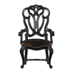 Stanley Furniture - Stanley Costa Del Sol Messalina's Blessings Arm Chair Artisan 971-81-70 Multicol - Shop for Dining Chairs from Hayneedle.com! The Stanley Costa Del Sol Messalina's Blessings Arm Chair Artisan 971-81-70 offers rich flavor for your dining room. The ultra-comfortable leather seat is accented with nailhead trim. The black finish on this chair is the perfect accent. The delicately bowed front legs and intricately detailed carved back make for European style that is the perfect finishing touch to any space.The Costa Del Sol CollectionFrom Portugal's white-washed beaches to Greece's sparkling azure waters the Costa del Sol collection blends traditional styles from Europe's southern sea coast with alluring Spanish scrolling and decadent carefree charm of a Tuscan country house. Old-World wood grain is brought to vivid life with rustic mid-tone finishes or hand-rubbed dark coffee colors buffed to a soft satin glow. Authentic distressing techniques like burnishing cow-tailing and axe marks enhance the well-loved heirloom appearance of each item in this matching collection.Stanley Furniture Craftsmanship Stanley Furniture's main objective is to produce quality and stylish furniture by using the best wood materials construction procedures and elegant finishes on their products to help you fashion your home decor the way you imagined. All of their furniture is hand-crafted from quality woods incorporating other superior materials such as aluminum glass plastic leather and marble. Every joint is carefully constructed (keeping wood's sensitivity to heat and humidity in mind) allowing for expansion and contraction. All joints are held together with glue and nail. Stanley's 30-step finishing process starts with an undertone stain that is applied to a hand-sanded piece. Next the stain is sealed with a wash coat then hand sanded again with filler applied to pack the wood pores and smooth out the surface. A sealer coat is then applied the piece is hand sanded again 