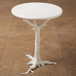 White Side Table - When it's too cool to venture outdoors, bring the outdoors in with a tree trunk table. I love the many variations of tree-inspired tables that I've seen over the years, and this one had me at hello with its modern white finish.