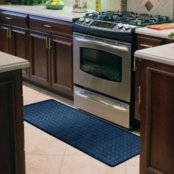 Anti-Fatigue Black Chef Mat 20x60 Lattice Runner - If you do a lot of moving about in your large kitchen, you'll need the Anti-Fatigue Black Chef Mat 20x60 Lattice Runner underfoot the whole way. Place this long runner along your most frequented path so you'll feel like you're walking on air instead of hard tile. Made from durable rubber foam with a thick, dense cushion core, this mat is medically proven to promote proper circulation and better posture while reducing muscle fatigue and stress. It's easy to wipe away spills, even though the mat is creatively designed to look just like black faux leather in a basket-weave pattern. An attached anti-slip backing ensures safe footing.