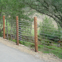 Wire Fencing - Wire fences are a perfect choice for livestock, deer control and perimeter fencing. A wire fence can also be used for decorative applications or to just create an open/airy look. All of our wire fence designs are galvanized for longevity and come in various types and gauges. We also offer vinyl coated welded wire for a more upscale look.