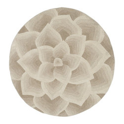 Rose Tufted Round Rug, Ivory - This is a pretty rug for under a round wood dining table. I love the petals; they're very different and appealing