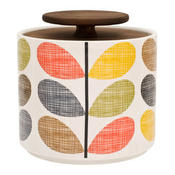 "Orla Kiely - Multi Stem Storage Jar - Stylish kitchen storage and organization from Orla Kiely featuring her classic Stem print on a versatile ceramic container with classic wood lid. Handmade in Portugal; pieces may display slightly varied characteristics. Measures: 4.5""w x 5""d, Volume: 1 Liter"