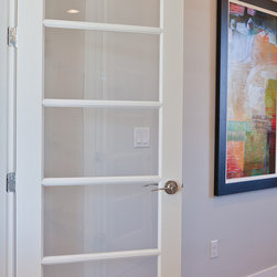 Doors - Redefine floor-to-ceiling elegance with a custom door designed to add light and air to any room. Photo courtesy of Infinity Homes.