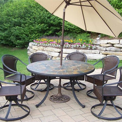 Oakland Living - Tuscany Stone Art 9-Pc Patio Dining Set - Includes table, six swivel chairs, tilting umbrella and stand. Fade, chip and crack resistant. Solid and sturdy yet trendy designs. Brass hardware. Warranty: One year limited. Made from natural stone, tubular iron with all weather resin wicker. Hardened powder coat finish in black. Minimal assembly required. Table: 54 in. Dia. x 29 in. H. Umbrella: 108 in. L x 108 in. W x 100 in. H (45 lbs.)Our stone art dining sets will be a beautiful addition to your patio, balcony or outdoor entertainment area. Stone art dining sets are perfect for any small space or to accent a larger space. The Oakland Stone Art Collection combines natural stone and modern designs giving you a rich addition to any outdoor setting.