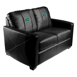 Dreamseat Inc. - University of Florida NCAA Gators Xcalibur Leather Loveseat - Check out this incredible Loveseat. It's the ultimate in modern styled home leather furniture, and it's one of the coolest things we've ever seen. This is unbelievably comfortable - once you're in it, you won't want to get up. Features a zip-in-zip-out logo panel embroidered with 70,000 stitches. Converts from a solid color to custom-logo furniture in seconds - perfect for a shared or multi-purpose room. Root for several teams? Simply swap the panels out when the seasons change. This is a true statement piece that is perfect for your Man Cave, Game Room, basement or garage.