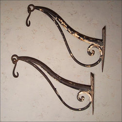 French  Ironwork Hangers - This Pair of Antique French Wrought Iron Hangers is the Ultimate, with Graceful, Refined Lines and Beautifully Executed. Fitted with a Shield Shaped Mounting Plate, and Wrought Hooks for Hanging Lanterns, Plants, or the Like.