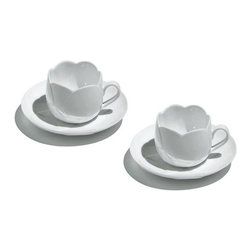 "Alessi Coffee and Tea - Alessi Coffee and Tea Tulip Teacup Set - Set of two coffee cups in bone china, with saucers.  A distillation of the design achievement of 2003's ""Tea & Coffee Towers"" project, these cups make the results accessible to the wider coffee-drinking public.  The designers of each Alessi limited edition coffee & tea service have been asked to design a simple coffee cup, one that would exhibit the essence of the project.  Hungarian architect Dezso Ekler's work is strongly influenced by the anthroposophic vision of Rudolf Steiner, as demonstrated by this evocative commentary on his Tulip cup designs.  He thought that all traditional porcelain cups were always decorated with flowers, even that their forms are also flower-like.  Even the very first porcelain cups, from one thousand years ago in ancient China, were fashioned in the form of flower-cups.  They were very rare and very expensive, because they were specially made for sacral purposes.  Manufactured by Alessi.Designed in 2005."