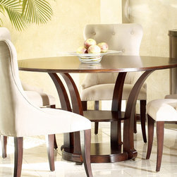 Frontgate - Metropolitan Dining Table - Crafted of mahogany. Ribbon striped mahogany veneer. Mid-level shelf for additional storage. Our Metropolitan Dining Table is a stylish addition to your dining area. This sleek, circular top table provides both form and function.. . .