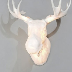"""Northern Lighting - Northern Lighting Moo wall sconce - The Moo wall sconce is a full scale wall-mounted Norwegian light moose head. Moo may be used both for indoor and outdoor decoration purposes. The figuratively shaped lamp body is made of poly-resin material, which gives a smooth and transparent flow of light. The bulbs placed inside the horns add an extra element of soft, sparkling and translucent light effect to the lamp.  Product Description: The Moo wall sconce is a full scale wall-mounted Norwegian light moose head. Moo may be used both for indoor and outdoor decoration purposes. The figuratively shaped lamp body is made of poly-resin material, which gives a smooth and transparent flow of light. The bulbs placed inside the horns add an extra element of soft, sparkling and translucent light effect to the lamp.   The inspiration behind the Moo lamp was found in northern Norway, in the breathtaking scenery of Hamar�y, where both of the designers have summer houses. Here the moose is frequently seen passing close to the houses and even over the lawns. The designers hope Moo will stand out as a post-modern kitch trophy, making the viewer smile happily as they recognize this """"king of the Norwegian forest"""". Large quantities in stock for immediate shipment! The protection grade for outdoor use is IP44.                          Manufacturer:            Northern Lighting                                         Designer:                        Ove Rogne, Trond Svendg�rd                                         Made in:            Norway                            Dimensions:                        Total dimensions (with horns) : W 29"""" (75 cm) x H 29"""" (75 cm) - projection 22.4"""" (57 cm)                                          Light bulb:                        Bulbs main body: 2 x med base Energy saving bulb. Max. 20 W             Bulbs horns: 2 x E14 Energy saving bulb. Max. 5 W                                         Material:            poly-resin"""