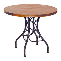 "South Fork Bistro Table - Give your cabin bar or dining room a dose of nature-inspired beauty with the South Fork Bistro Table. Featuring a hand-hammered and fired tabletop made using a hand-applied  Old World technique for variations on each piece  this bistro table is made from high-quality recycled copper and hand-forged iron. The artisan-crafted iron base features graceful twigs and branches in a black finish. A wax coating adds protection. Measures 36""W x 36""D x 30""H. ~ Ships from the manufacturer. Allow 4 to 6 weeks."