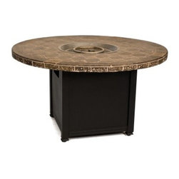 Woodard Ashford Aluminum 48 in. Round Fire Pit Table - The Woodard Ashford Aluminum 48 in. Round Fire Pit Tableis a perfect addition to your outdoor living area. Standing 26.3 inches tall it's the perfect height for enjoying a meal or serving drinks and appetizers at a large get-together with family and friends. The cast aluminum construction is built to withstand the outdoor elements and the built-in stainless steel propane burner is not only easy to operate but it serves up to 40 000 BTUs of heat so you can enjoy an evening out even when the snow is falling! The perfectly round tabletop which the burner centers is a fascinating mosaic of stone tiles sure to elevate your exterior decor. And speaking of your exterior decor you can better complement your existing style by choosing the perfect frame finish from a plethora of color options. Choose from the following: black bronze chestnut brown cognac espresso graphite hammered pewter hammered white khaki Mayan gold sandstone smooth limestone textured black textured cypress Tuscan sand and twilight. Measures 48 diam. x 6.3H inches. NOT for indoor use. No accessories necessary! This fire pit comes with 16.5 lbs. of clear glass beads that fill the bowl and cover the burner to give your fire a sophisticated clean look. Woodard: Hand-crafted to Withstand the Test of Time For over 140 years Woodard craftsmen have designed and manufactured products loyal to the timeless art of quality furniture construction. Using the age-old art of hand-forming and the latest in high-tech manufacturing Woodard remains committed to creating products that will provide years of enjoyment. Superior Materials for Lasting Durability Each wrought iron piece is hand-formed using solid iron stock: the heaviest available. The technique used to create Woodard wrought iron furniture has been handed down from generation to generation. To this day expert workers use anvils and hammers to forge intricate detail in the iron. Aluminum pieces bear Woodard's trademark for excellence: a core of seamless virgin aluminum: the heaviest purest and strongest available. The wall thickness of Woodard frames surpasses the industry's most rigid standards. Cast aluminum furniture is constructed using only the highest grade aluminum ingots which are the purest and most resilient aluminum alloys available. These alloys strengthen the furniture and simultaneously render it malleable. The end result is a fusion of durability and beauty that places Woodard Aluminum furniture in a league of its own. Fabric Finish and Strap Features All fabric finish and straps are manufactured and applied with the legendary Woodard standard of excellence. Each collection offers a variety of frame finishes that seal in quality while providing color choices to suit any taste. Current finishing processes are monitored for thickness adhesion color match gloss rust-resistance and and proper curing. Fabrics go through extensive testing for durability and application as well as proper pattern weave and wear. Most Woodard furniture is assembled by experienced professionals before being shipped. That means you can enjoy your furniture immediately and with confidence. Together these elements set Woodard furniture apart from all others. When you purchase Woodard you purchase a history of quality and excellence and furniture that will last well into the future.