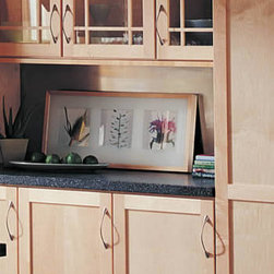 Counter Between Utility Cabinets - Placed between two Utility Cabinets, a Countertop creates a surface area separated from the main work area counters. It's ideal for displays, storage, or a cookie tray.