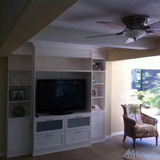 Tropical Home Theater by Coastal Living Remodelers