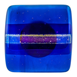 Vivien Hart - Twilight Knob - These fused glass knobs can add pizzazz to any room or special furniture piece. The knobs are lovingly handmade in my home studio. The object of these knobs is to bring art to a functional object that you can enjoy using every day. Each knob or pull is made using 2,3,4 or in some cases 5 layers of cut glass or glass powders. I often use clear glass either on top of or in between design layers to create a sense of depth. Several of my designs are also three-dimensional in nature. This requires them to be fired in multiple stages to create different effects. Some knobs are fired once while others are fired many times. The knob backing is made of a sturdy stainless steel and is hourglass shaped. The hardware does not cover the back completely thus allowing the glass knob to capture and reflect light. Matching pulls are available with some knob designs. Overall the knobs are consistent in size and color. However each piece is handmade so there may be slight variations between knobs.