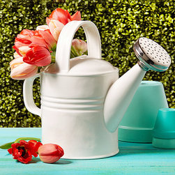 Avent Garden Watering Can - A silver-plated spout brings infinite charm to this lovely ceramic home accent, the Avent Garden Watering Can.  Its pure white and bright silver colors draw attention to high points in the classic design familiar from formal country gardens.  Use as a vase, vessel, or sculpture to lend an evocative tone to a sun porch or to bring the outdoors into your living space.