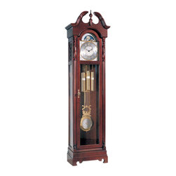 """Ridgeway Clocks - Ridgeway 18th Century Inspired All Wood Grand - This elegant, ornamental grandfather clock features a strong, solid hardwood and select veneer design with an attractive Cherry finish. The pendulum and weights are easily viewable through a strong glass pane, and the dial of the clock is polished to perfection and features raised Arabic numbers for a classical look. * A softly curved swan's neck pediment, turned finial and a full cherryveneer crown return, adds elegance to this clock finished in Glen ArborCherry on select hardwood and veneers.. At the base of the front lockingdoor is an embossed molding to add the final touch.. Reeded columns with decorative top caps border the brass finished dial.The dial features raised Arabic numerals, center design and cornerspandrels as well as a functioning lunar calendar.. The detailed designon the dial is carried through to the banded weight shells and 8 5/8"""" (220mm) lyre pendulum decorated disk.. Two lower side glass panels allowviewing of the beautiful brass weights and swinging pendulum from anyangle.. A chain driven movement plays the serene melody of the Westminsterchime and has a chime silence switch on the dial.. 82 H x 22 W x 13 D in."""