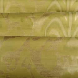 Belfour Silk Fabric in Sage - Belfour in Sage is a green silk fabric with a complimentary gold shaded base. The ikat-style pattern adds an eye-catching element to interior designs. This European fabric works perfectly for drapery and other window treatments or bedding and pillows and has a superior quality. Made from 100% silk with a repeat of 31.9″. Width: 52.4″ This designer fabric comes directly from Europe, please allow 2 weeks for delivery.